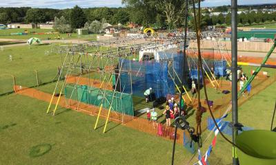 Abseil ropes ready for a participant, with a scaffold crate stacking tower in the background.